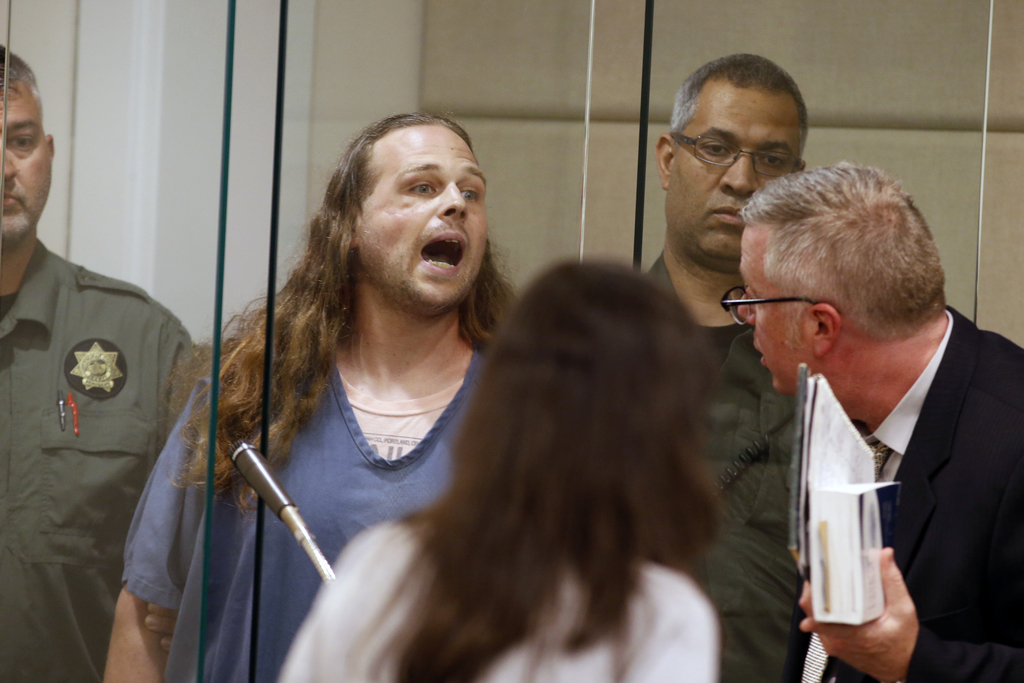 Jeremy Joseph Christian shouts as he is arraigned in Multnomah County Circuit Court in Portland, Ore., Tuesday, May 30, 2017. Authoriti...