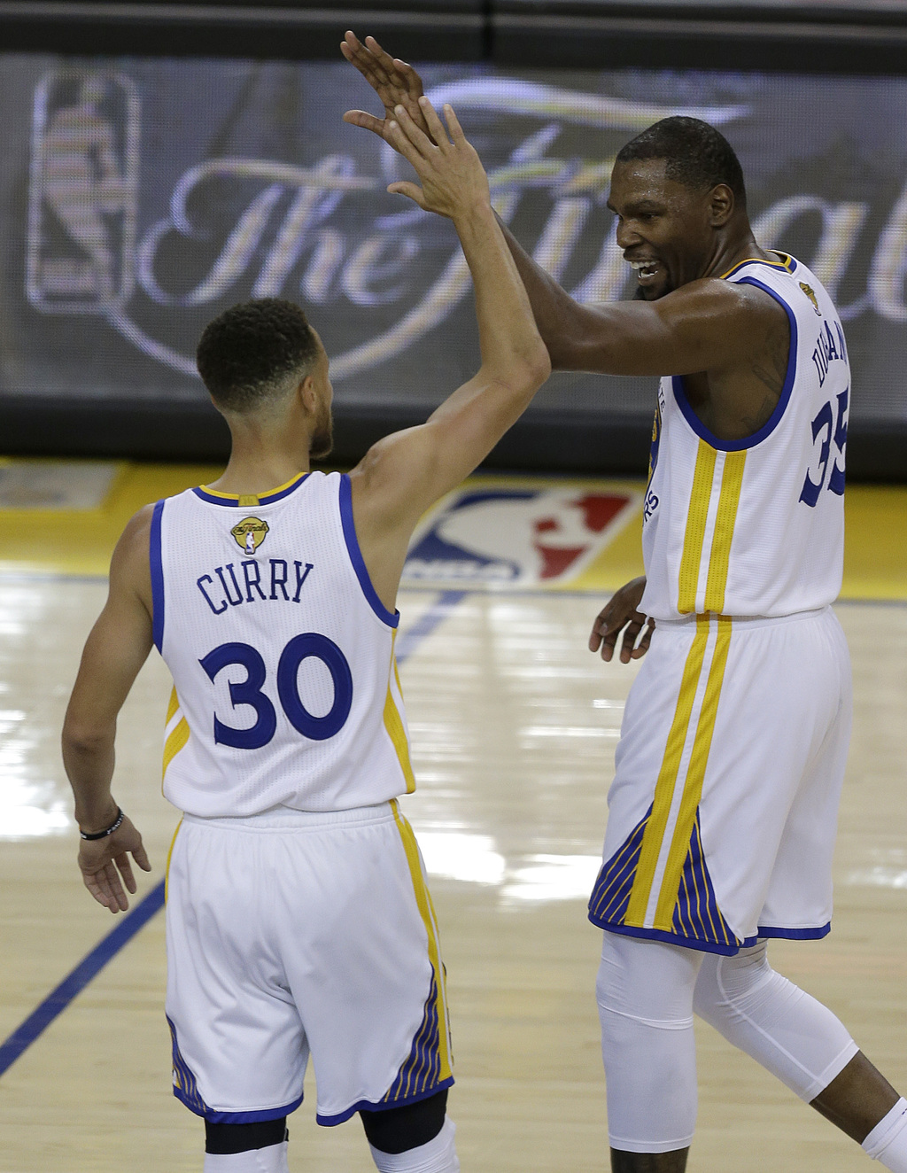 65597e304047 Golden State Warriors guard Stephen Curry (30) and forward Kevin Durant  react after scoring