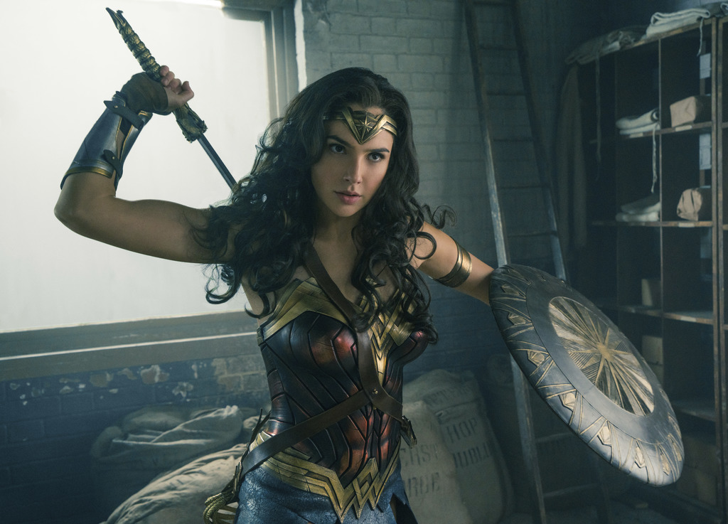 """This image released by Warner Bros. Entertainment shows Gal Gadot in a scene from """"Wonder Woman."""" The film grossed $103.1 million in No..."""