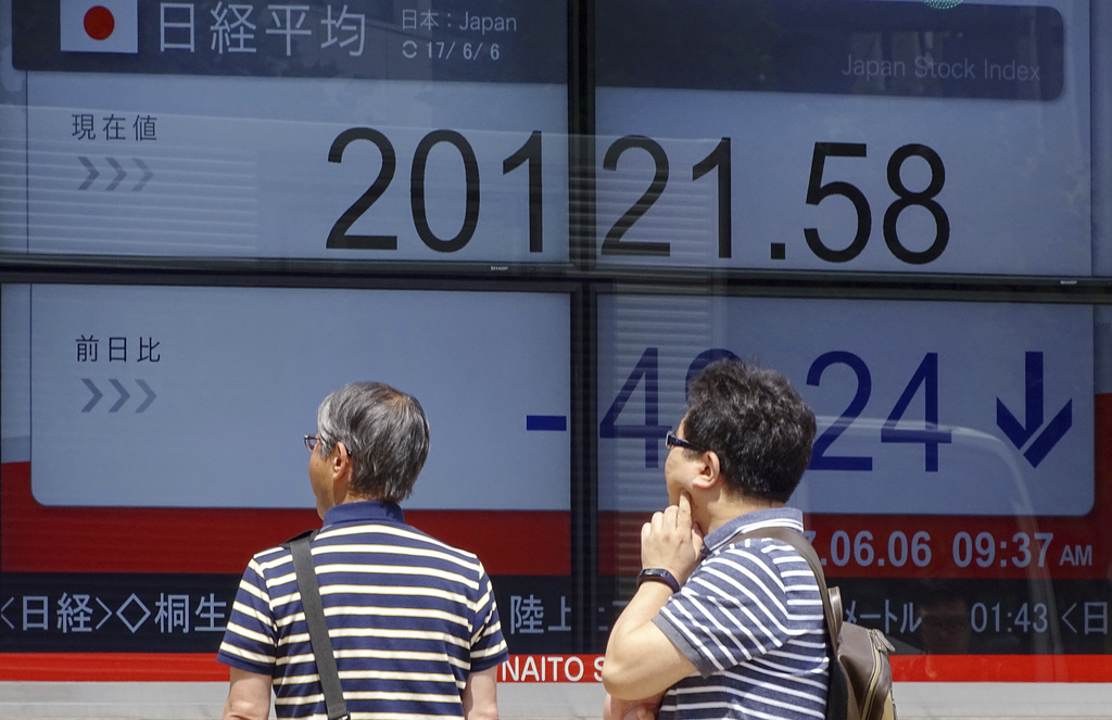 Asian stocks mostly lower following decline on Wall Street