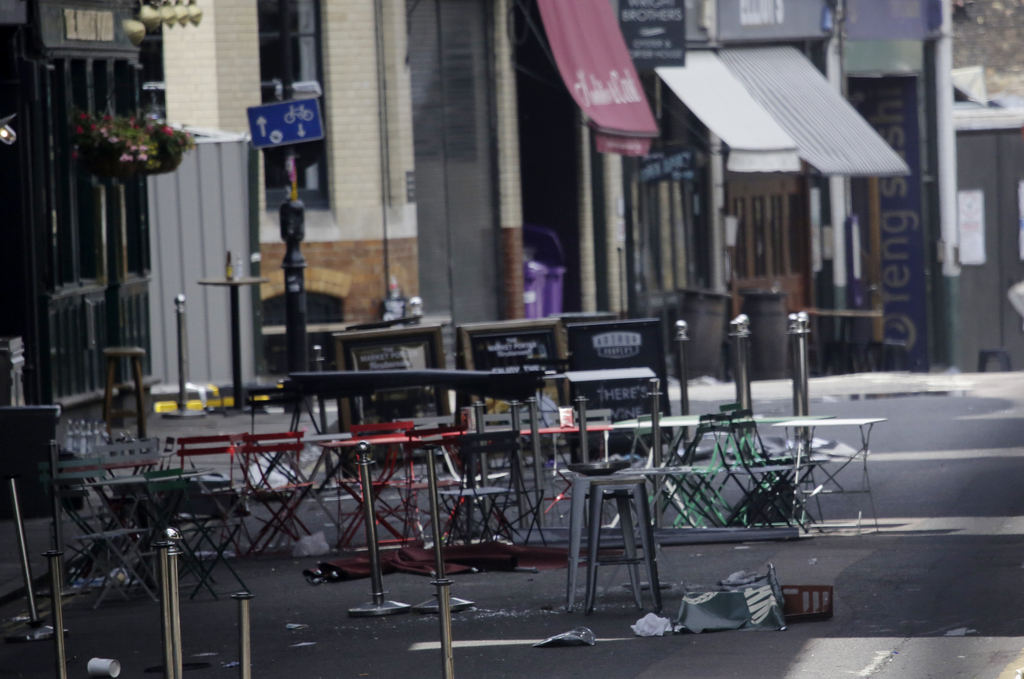 Debris remains in the street from Saturday's attack in Borough Market, London, Wednesday, June 7, 2017. London officials said a large p...