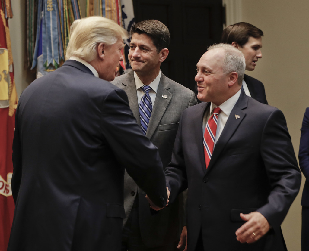 President Donald Trump, left, greets House Majority Whip Steve Scalise of La., before the start of a meeting with House and Senate Lead...