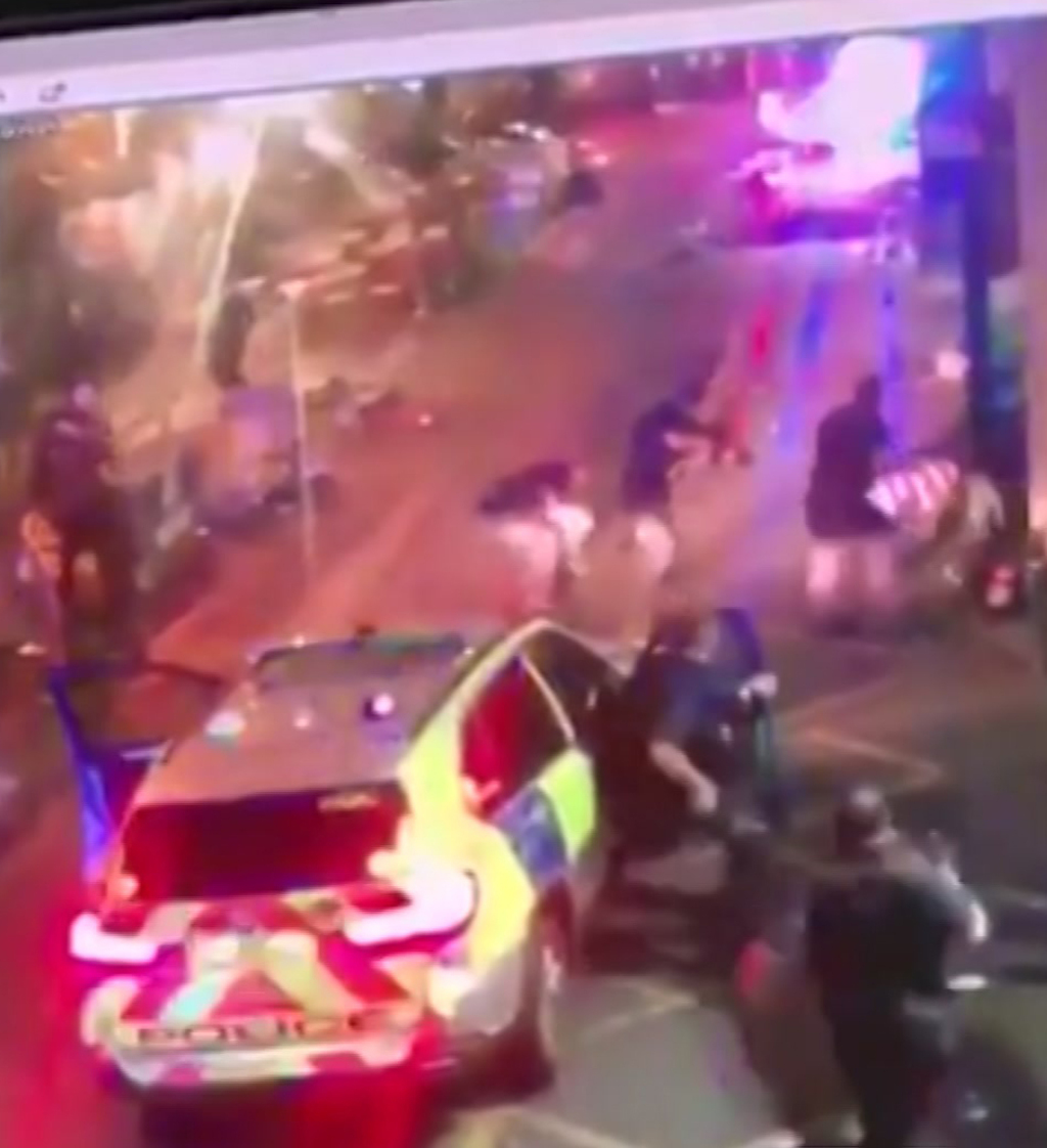 In this image taken from video which emerged on social media shows police surround an attacker on ground at right during the terror
