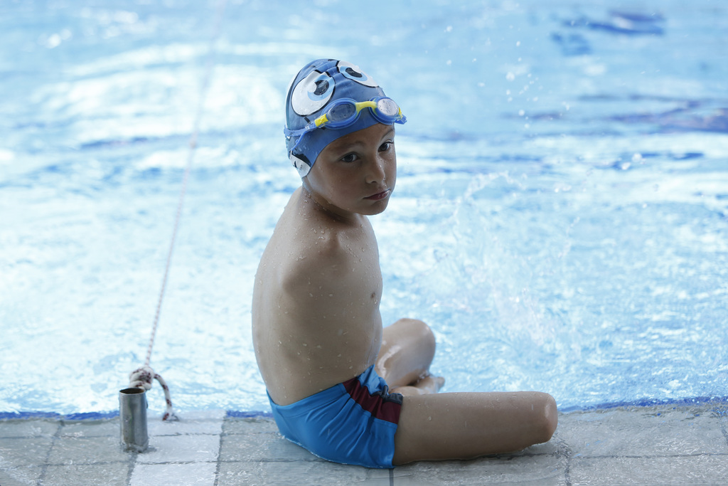 in this photo taken on thursday june 8 2017 ismail zulfic rests at the edge of of the olympic swimming pool in in sarajevo bosnia