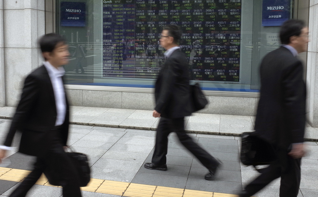 Asia shares lag record Wall Street, cautious of Fed plans