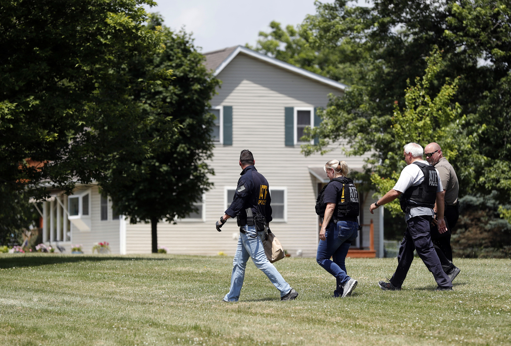 Law enforcement investigate outside the home of James T. Hodgkinson on Wednesday, June 14, 2017, in Belleville, Ill. Officials said Hod...