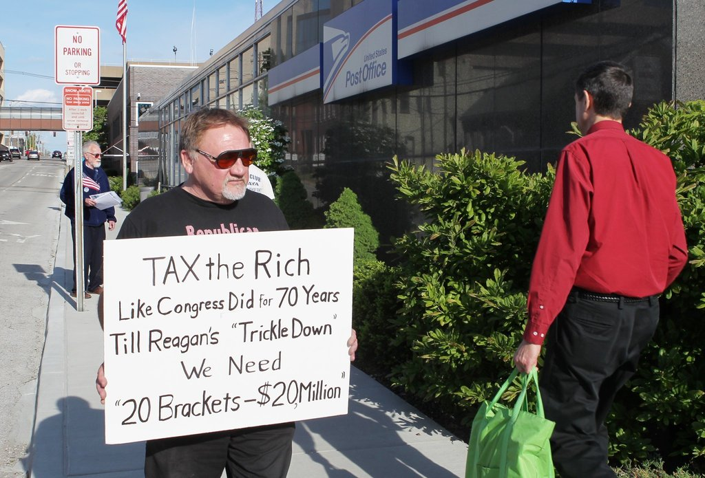 FILE - In this April 17, 2012, photo, James Hodgkinson of Belleville protests outside of the United States Post Office in Downtown Bell...