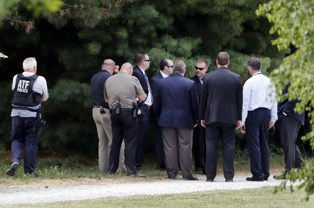 Law enforcement talk while investigating outside the home of James T. Hodgkinson on Wednesday, June 14, 2017, in Belleville, Ill. Offic...