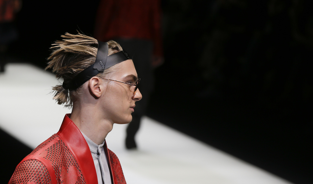 A model wears a creation part of the Emporio Armani men's Spring-Summer 2018 collection, that was presented in Milan, Italy, Saturday, ...