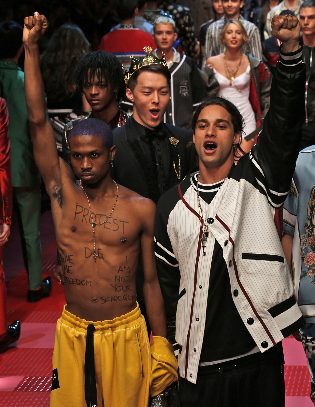 Models wear creations from Dolce&Gabbana's men's Spring-Summer 2018 collection, presented in Milan, Italy, Saturday, June 17, 2017. (AP...