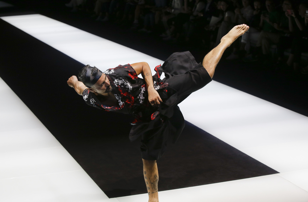 A model performs on the catwalk as he wears a creation part of the Emporio Armani men's Spring-Summer 2018 collection, that was present...