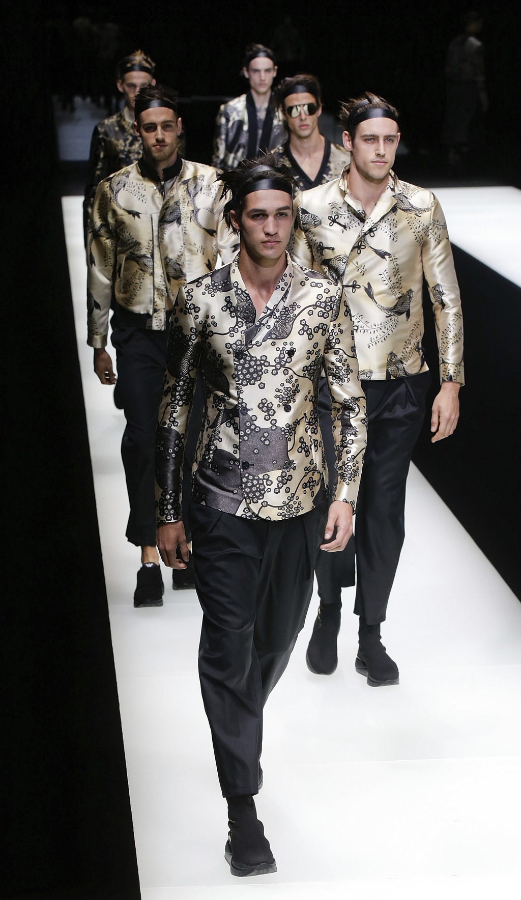 Models wear creations part of the Emporio Armani men's Spring-Summer 2018 collection, that was presented in Milan, Italy, Saturday, Jun...