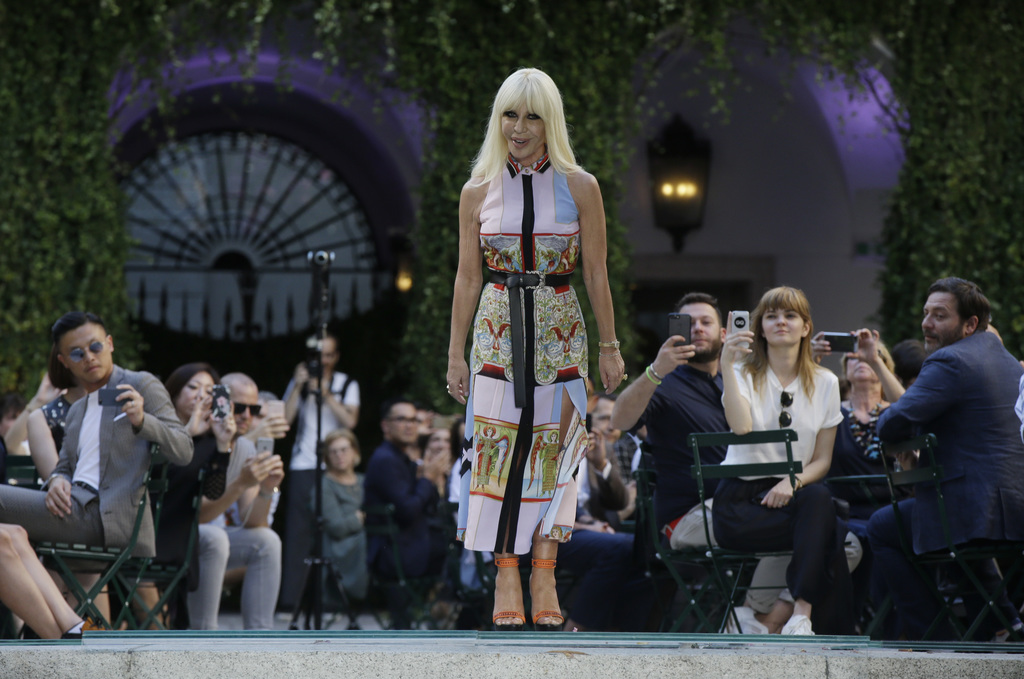 Italian fashion designer Donatella Versace acknowledges the applause of the audience at the end of the Versace men's Spring-Summer 2018...