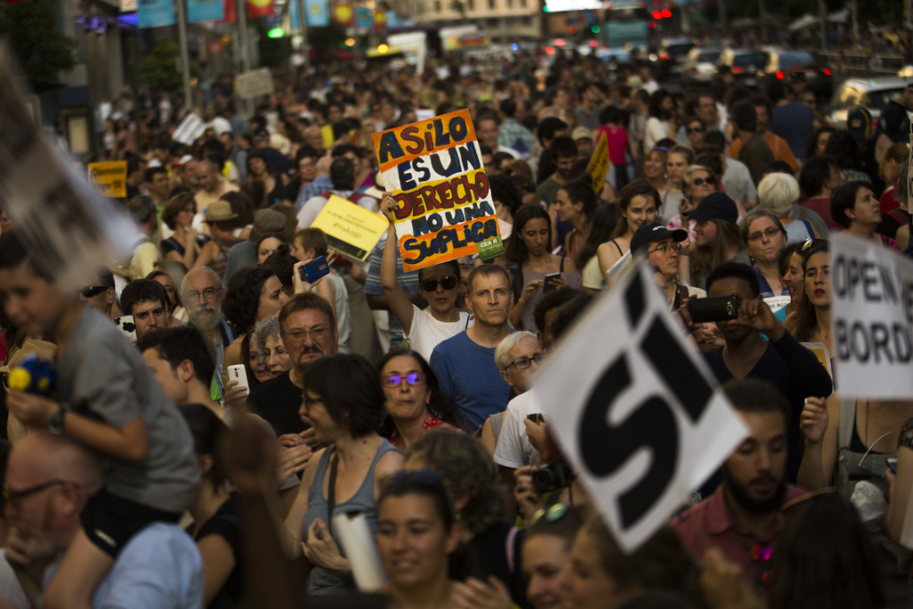 Marchers in Madrid urge Spain to take in more refugees
