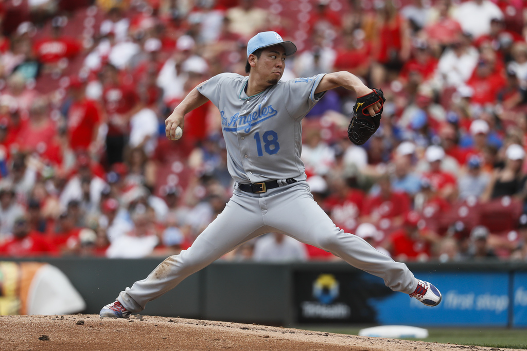 Los Angeles Dodgers starting pitcher Kenta Maeda throws in the second inning of a baseball game against the Cincinnati Reds, Sunday, Ju...