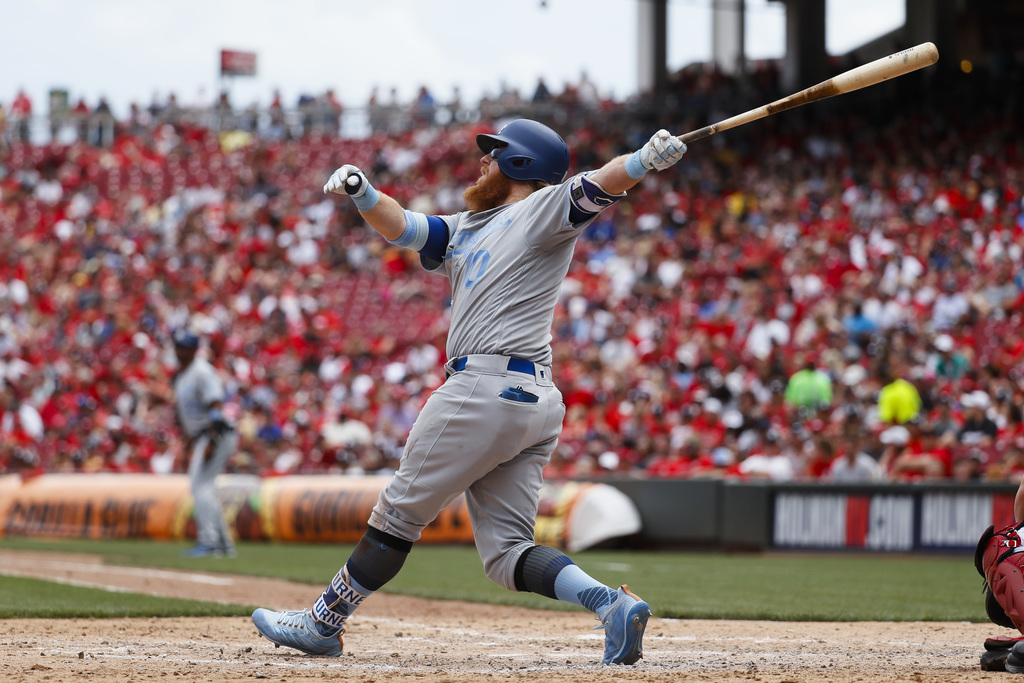 Los Angeles Dodgers' Justin Turner hits a three-run home run off Cincinnati Reds relief pitcher Wandy Peralta in the sixth inning of a ...