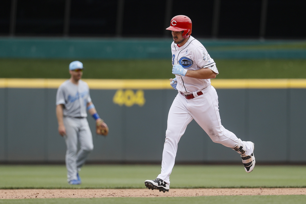 Cincinnati Reds' Adam Duvall runs the bases after hitting a solo home run off Los Angeles Dodgers relief pitcher Grant Dayton in the si...