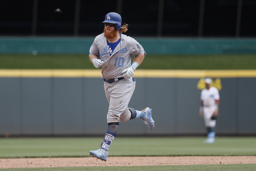 Los Angeles Dodgers' Justin Turner runs the bases after hitting a three-run home run off Cincinnati Reds relief pitcher Wandy Peralta i...
