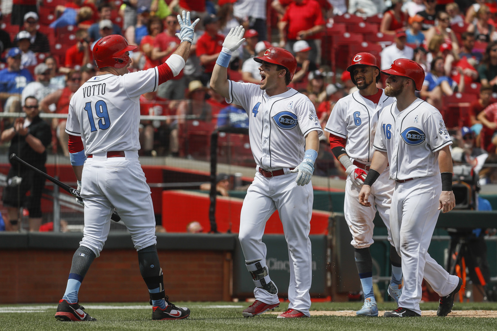 Cincinnati Reds' Scooter Gennett (4) celebrates with Joey Votto (19), Billy Hamilton (6), and Tucker Barnhart (16) after hitting a thre...