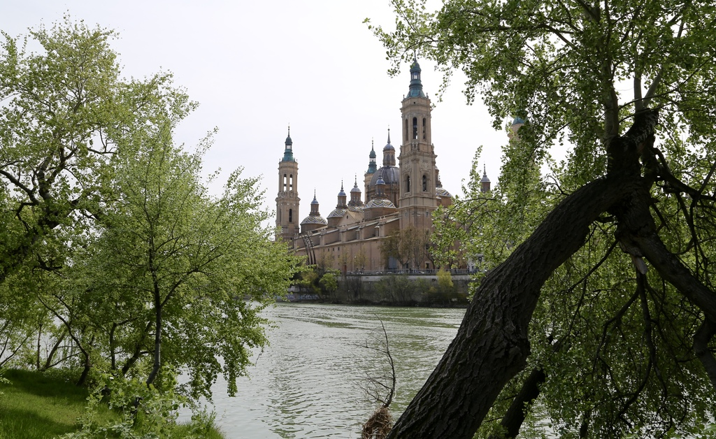 This March 26, 2017 photo shows a view of Zaragoza's Basilica del Pilar from the banks of the River Ebro. Tree-lined paths make the riv...
