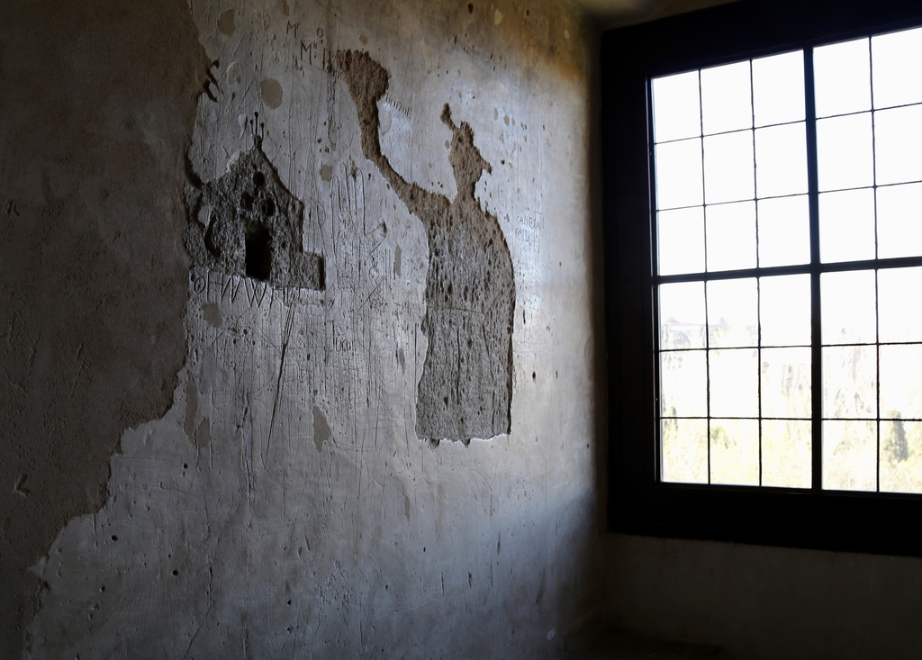 This March 28, 2017 photo shows graffiti and other markings left behind by prisoners locked in the Aljaferia tower in Zaragoza, Spain, ...
