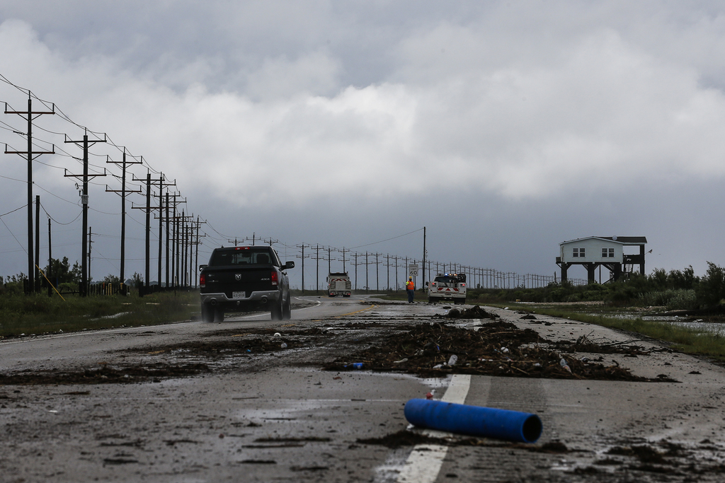 Debris covers State Highway 87 after Tropical Storm Cindy made landfall earlier Thursday, June 22, 2017 on the Bolivar Peninsula in Tex...