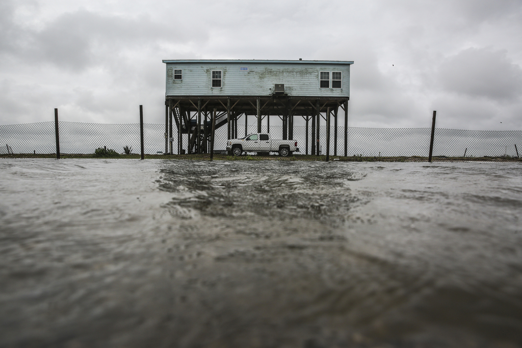 A house alongside State Highway 87 sits on a small island after Tropical Storm Cindy brought high tides as it made landfall earlier Thu...