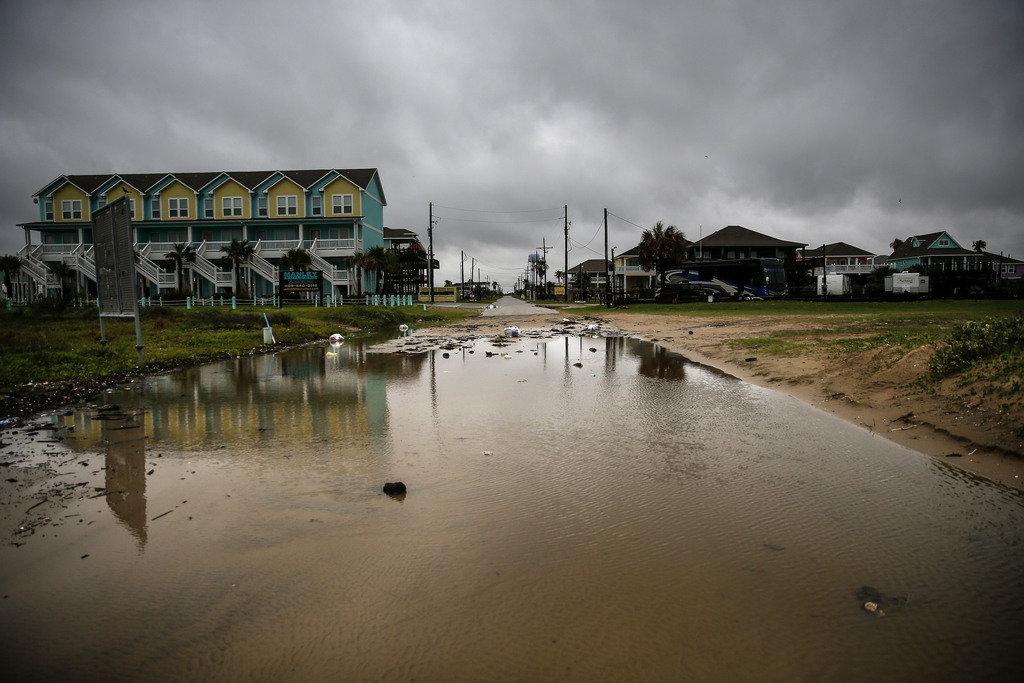 Water and debris, washed up past the beach by Tropical Storm Cindy, sit on Kahla Drive Thursday, June 22, 2017, in Crystal Beach, Texas...