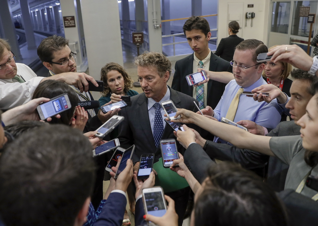 Sen. Rand Paul, R-Ky., speaks to reporters at the Capitol after Republicans released their long-awaited bill to scuttle much of Preside...