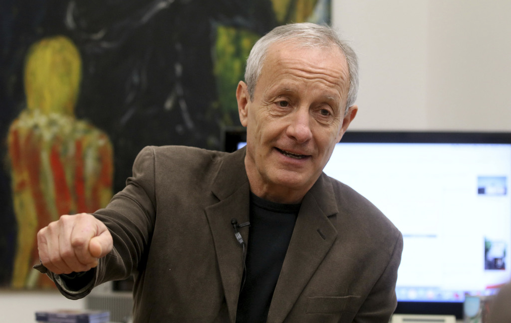 FILE - In this file photo taken Monday, Feb. 13, 2017, Peter Pilz from the Austrian Green party speaks in Vienna. An Austrian law banni...