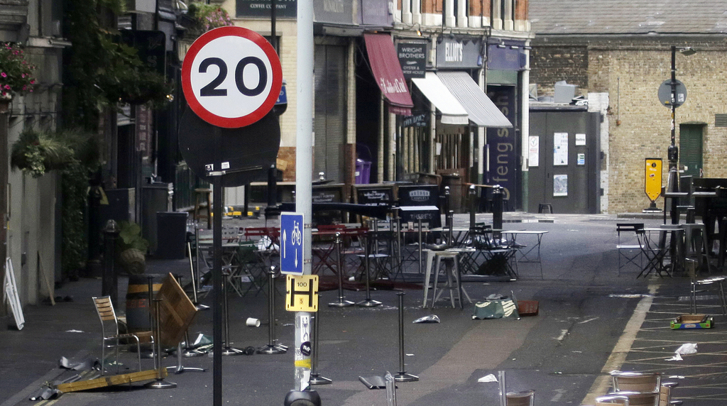 FILE - In this June 7, 2017 file photo, debris from Saturday's attack in Borough Market, London, remain in the street. The jihadis' tar...