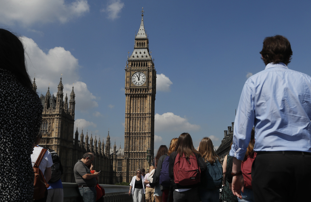 FILE - In this May 25, 2017 file photo, people observe a minute of silence in Westminster in London, after the suicide attack at an Ari...