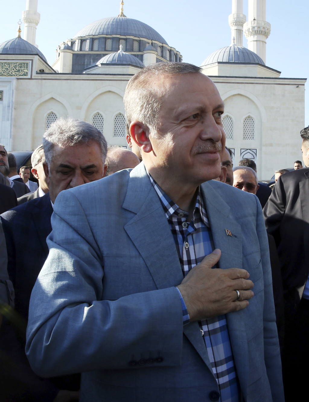 Turkey's President Recep Tayyip Erdogan smiles to his supporters after the Eid al-Fitr prayers in Istanbul, early Sunday, June 25, 2017...
