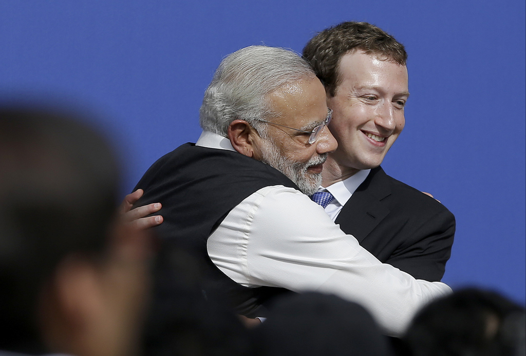 FILE - In this Sept. 27, 2015, file photo, Facebook CEO Mark Zuckerberg, right, hugs Prime Minister of India Narendra Modi at Facebook ...