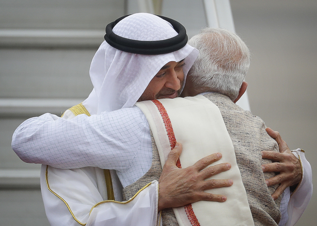 FILE - In this Jan. 24, 2017, file photo, Indian Prime Minister Narendra Modi, right, hugs Abu Dhabi's crown prince, Sheikh Mohammed bi...