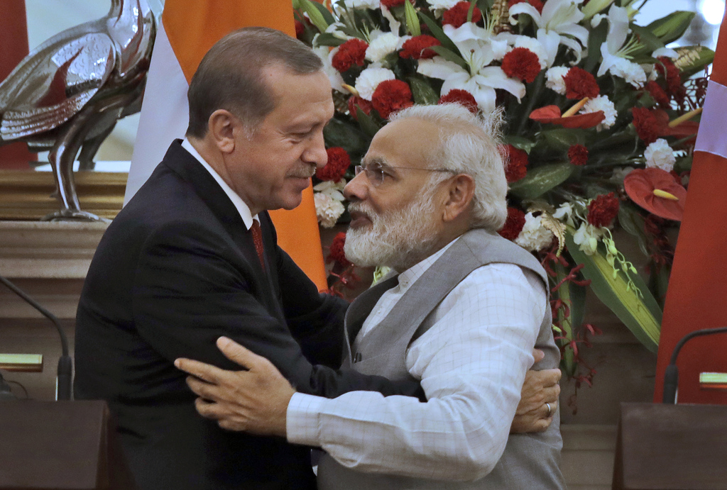 FILE - In this May 1, 2017, file photo, Indian Prime Minister Narendra Modi, right, hugs Turkish President Recep Tayyip Erdogan in New ...