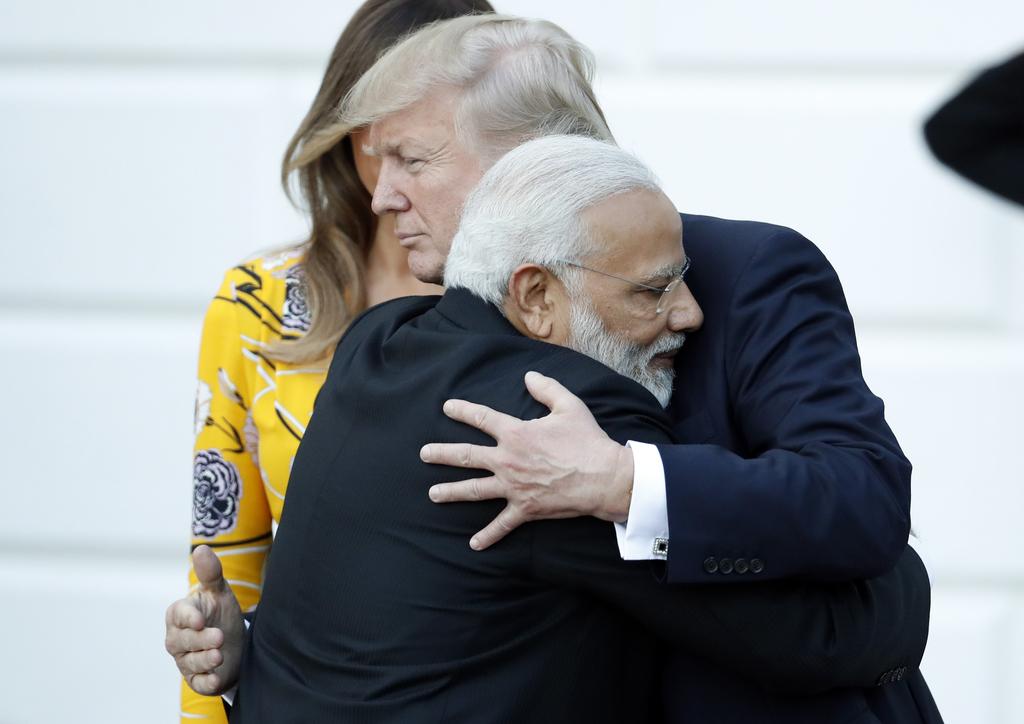 FILE - In this June 26, 2017, file photo, Indian Prime Minister Narendra Modi hugs President Donald Trump as Modi departs the White Hou...