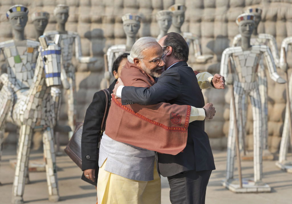 FILE - In this Jan. 24, 2016, file photo, Indian Prime Minister Narendra Modi, left and French President Francois Hollande hug at the R...