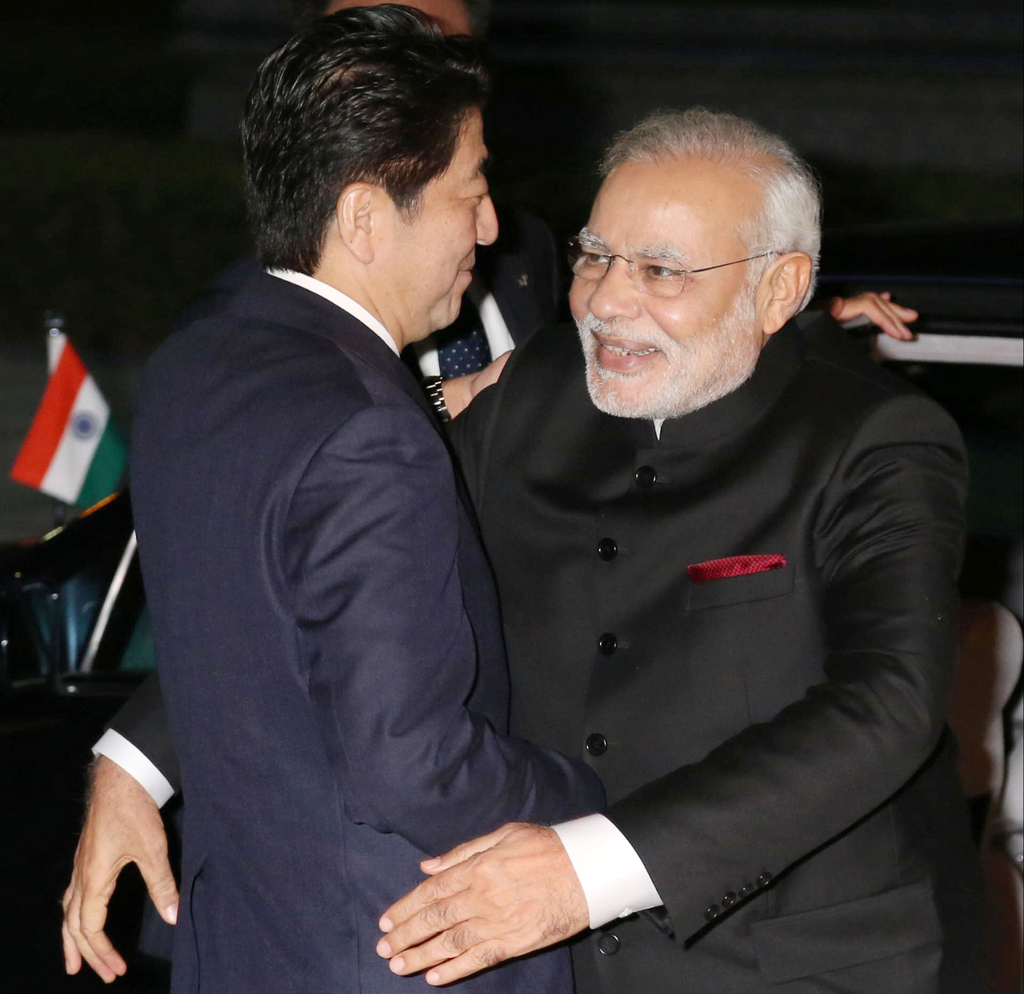FILE - In this Aug. 30, 2014, file photo, Indian Prime Minister Narendra Modi, right, is welcomed by his Japanese counterpart Shinzo Ab...
