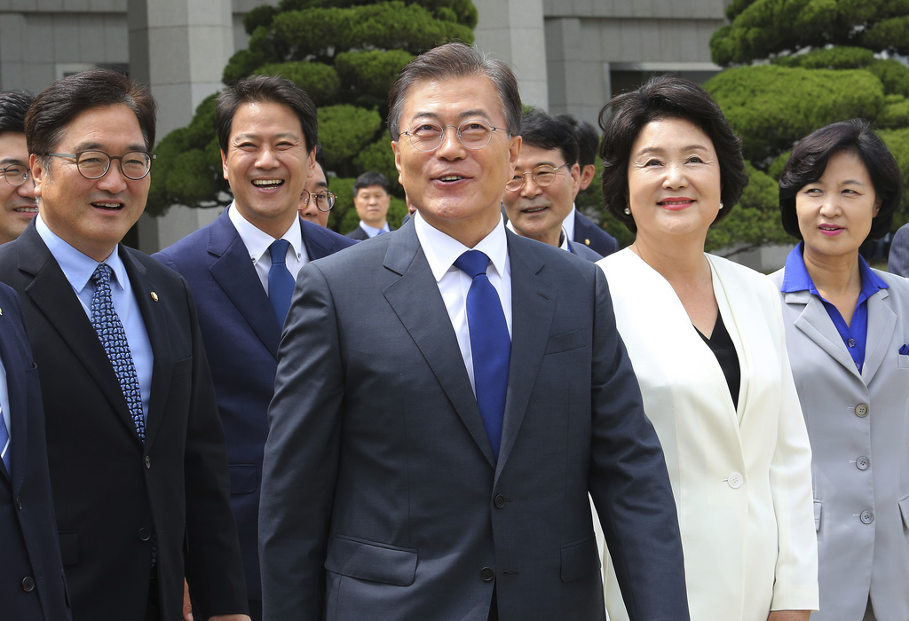 South Korean President Moon Jae-in, center, arrives to leave for the United States at the Seoul military airport in Seongnam, South Kor...