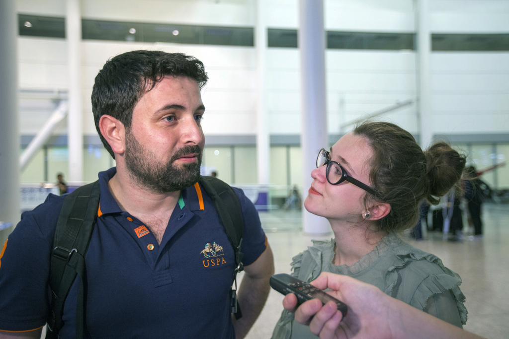 In this June 16, 2017 photo, Khaled Almilaji and his wife Jehan Mouhsen speak to a reporter after reuniting at Pearson International Ai...