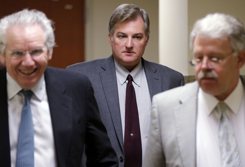 In this Thursday, June 29, 2017, photo, former Tulsa Police officer Shannon Kepler, center, exits the courtroom during his trial at the...