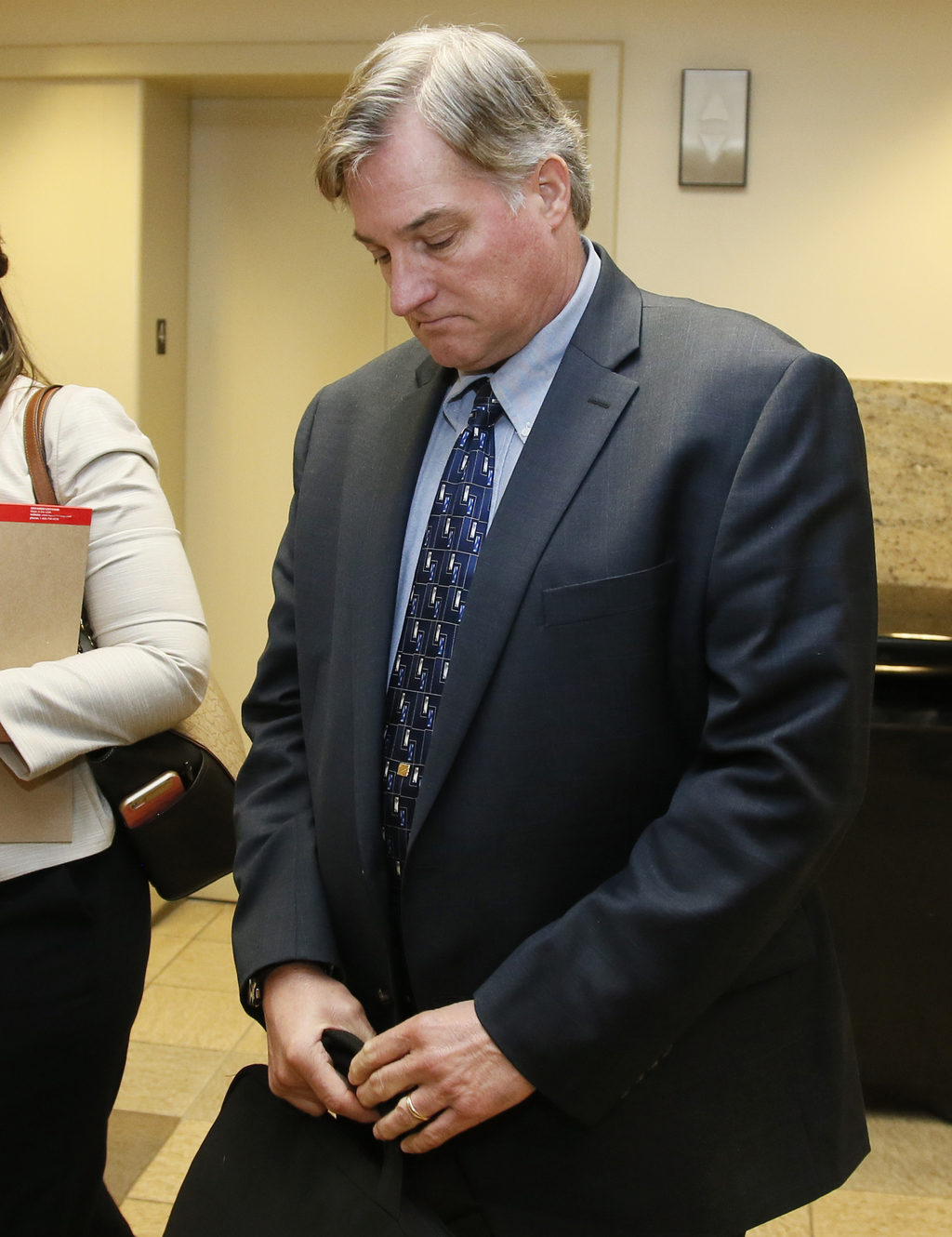 In this Friday, June 30, 2017 photo, Shannon Kepler, leaves the courtroom for a lunch break in his trial in Tulsa, Okla. Kepler, a form...