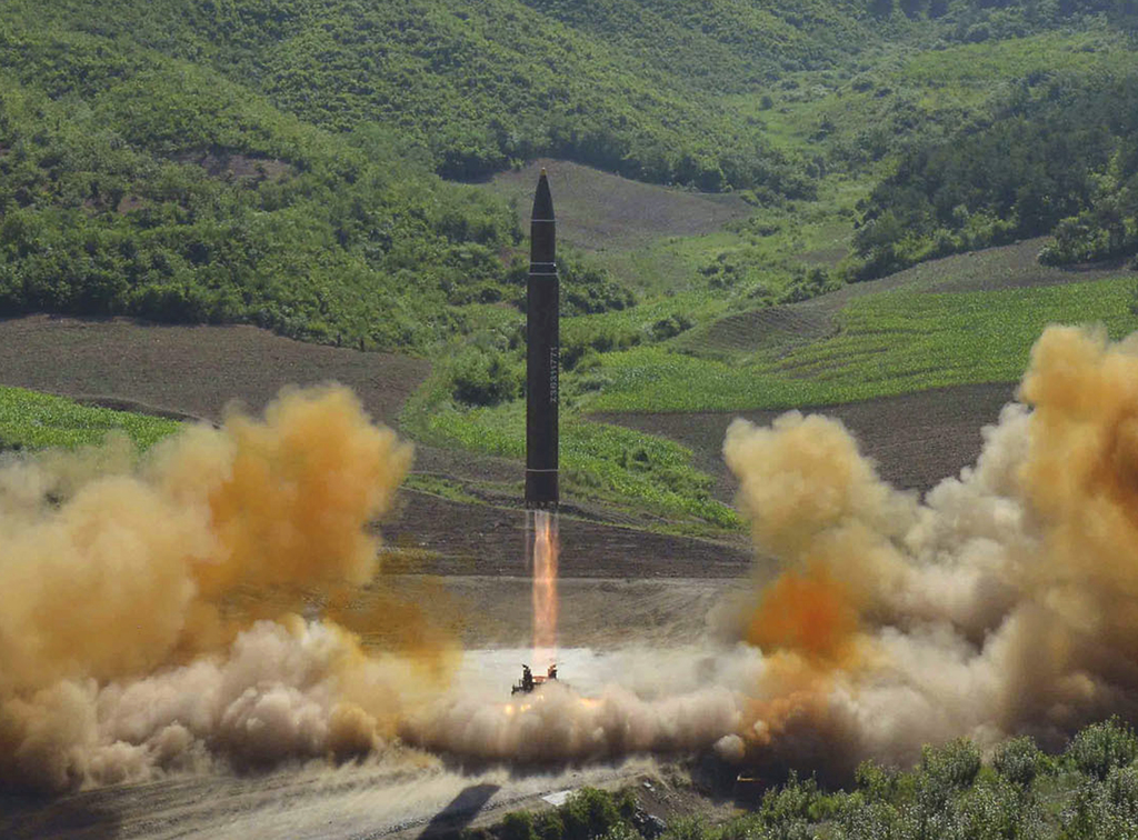 FILE - This file photo distributed by the North Korean government shows what was said to be the launch of a Hwasong-14 intercontinental ballistic miss...
