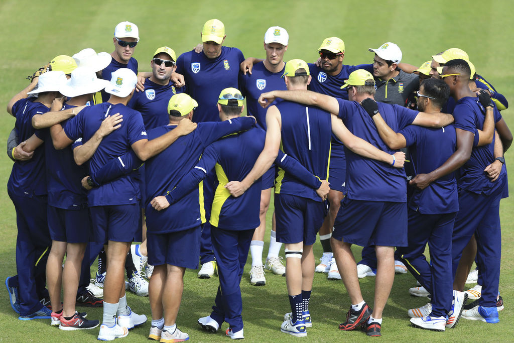 South Africa's team huddle including captain Dean Elgar top second left facing camera during the nets session at Lord's London Tue