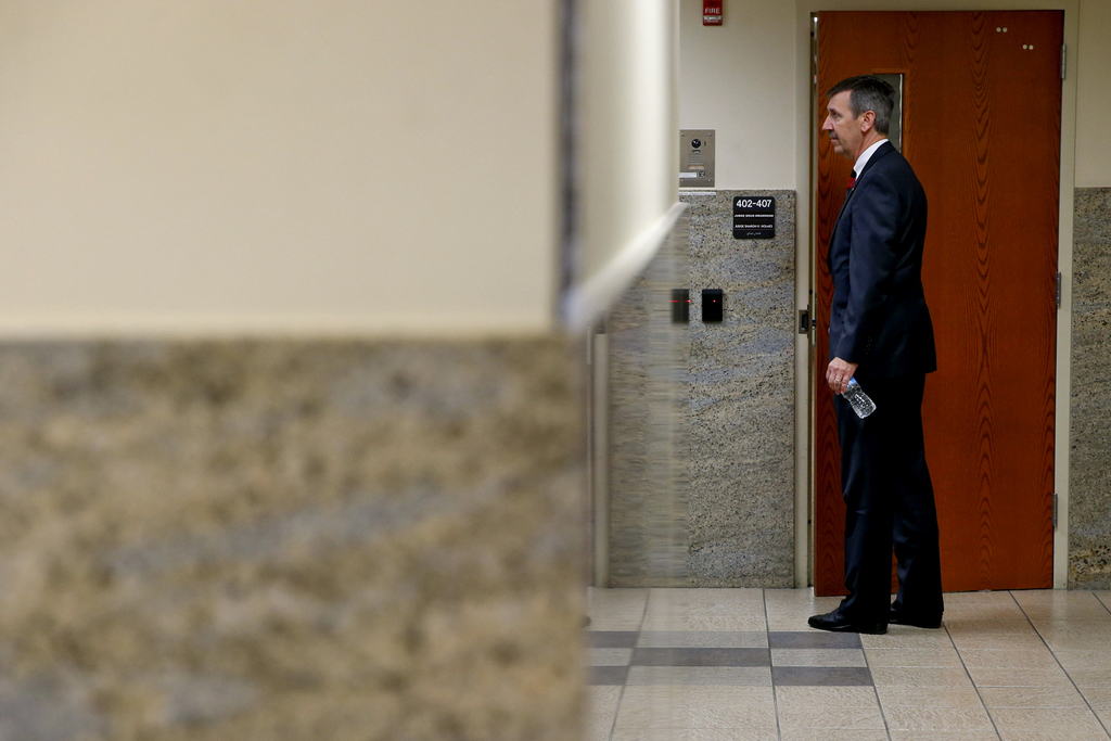 Tulsa District Attorney Steve Kunzweiler walks down a hallway while the jury deliberates in the murder trial of Shannon Kepler at the T...
