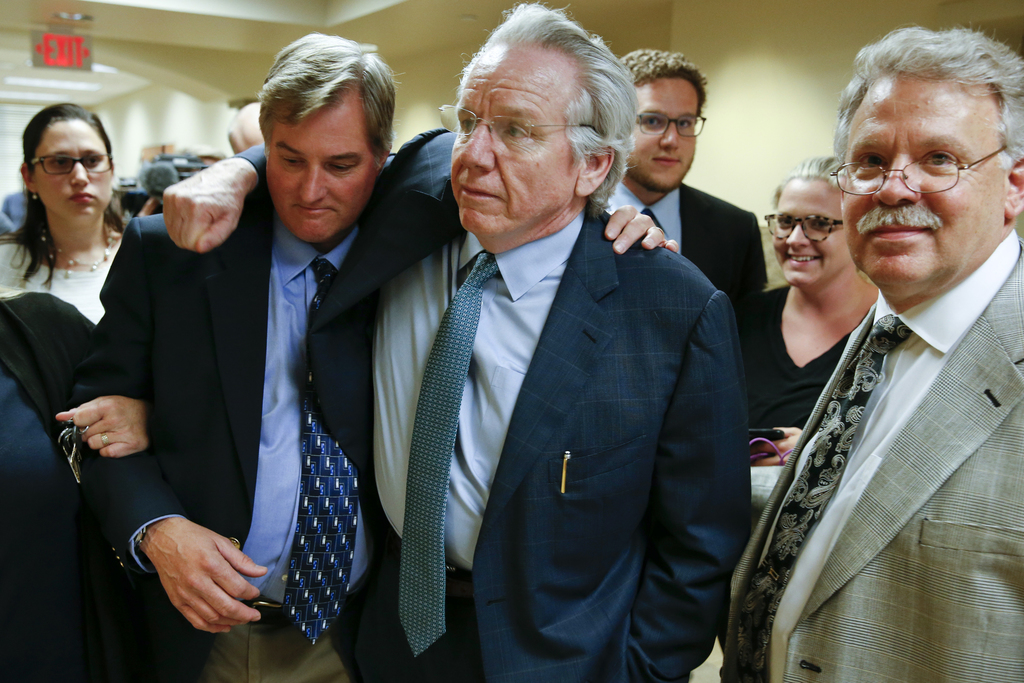 Shannon Kepler celebrates with his attorney, Richard O'Carroll, after a hung jury verdict was announced at the Tulsa Country Courthouse...