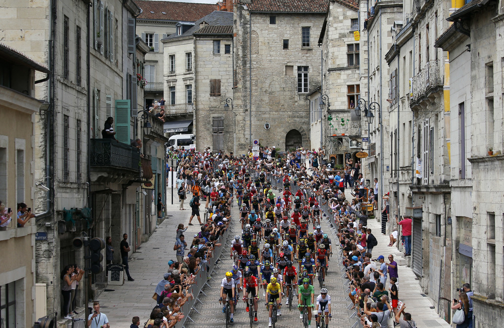 The pack rides in Perigueux during the tenth stage of the Tour de France cycling race over 178 kilometers (110.6 miles) with start in Perigueux and fi