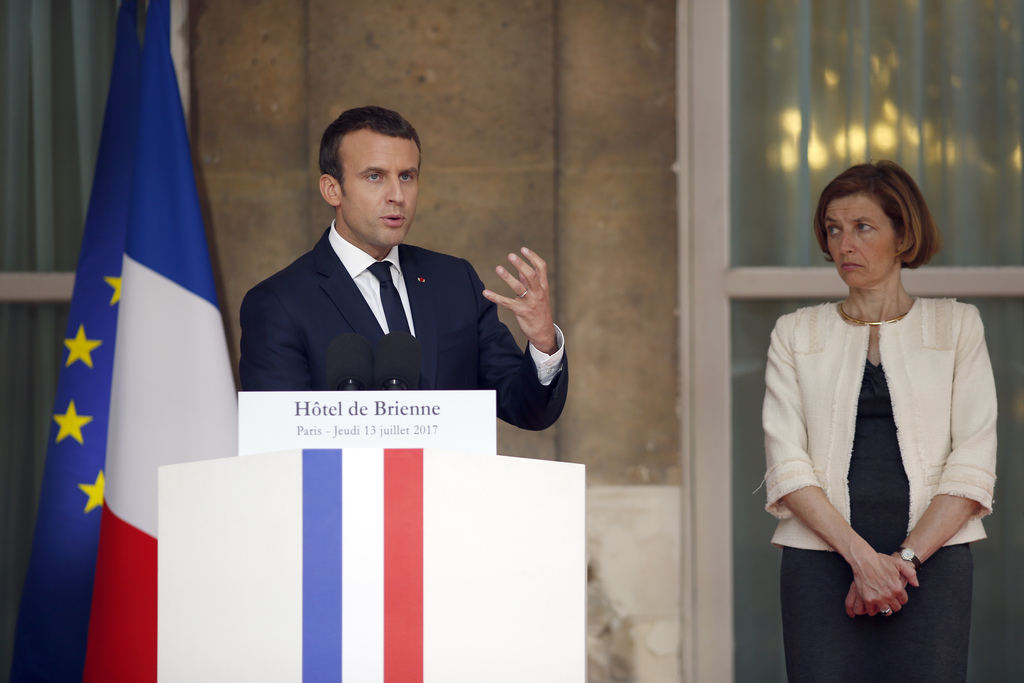French President Emmanuel Macron flanked by French Defense Minister Florence Parly delivers a speech during a reception in honor of the French Army fo...