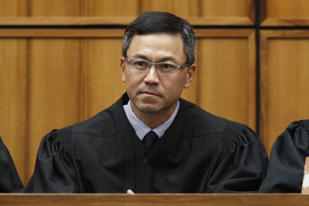 FILE - This Dec. 2015 file photo shows U.S. District Judge Derrick Watson in Honolulu. Watson on Thursday, July 13, 2017, expanded the list of family ...